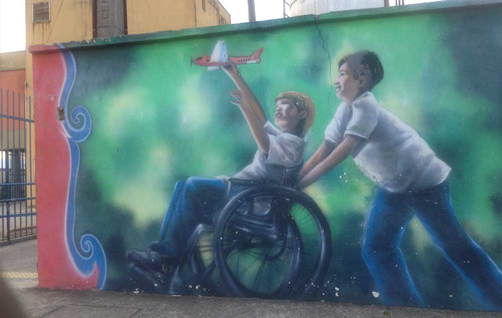Grafite de criança com deficiência